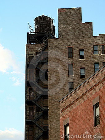 Old buildings in New York City against a bright sky