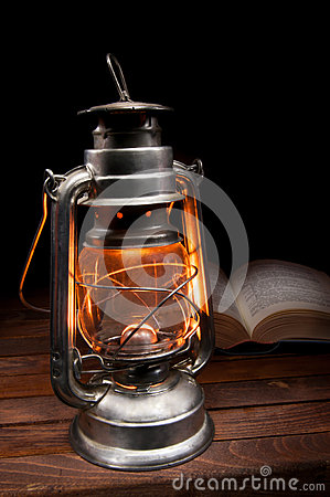Old burning oil lamp