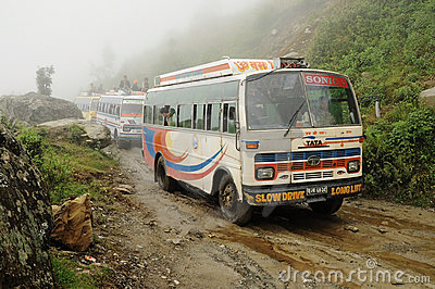 Old buses on very bad muddy road, Nepal Editorial Stock Image