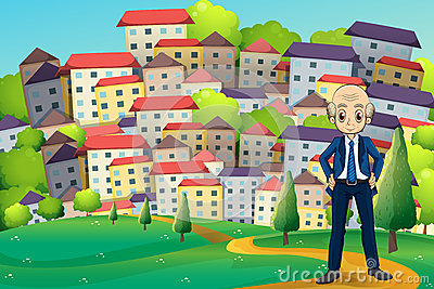 An old businessman standing at the hilltop across the buildings