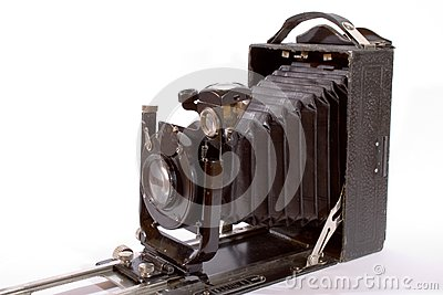Old camera isolated on white
