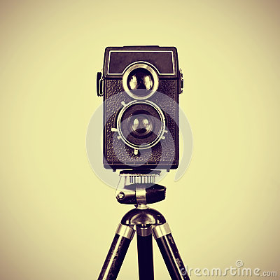 Old camera in a tripod