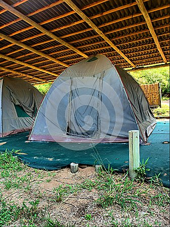 Old camping tent under roof