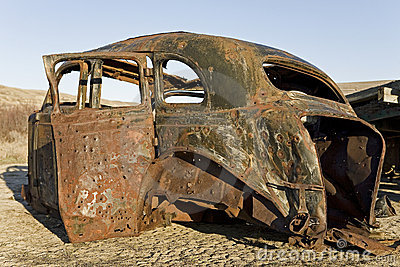 Old car carcass with bullet holes
