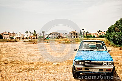 old car in desolate landscape
