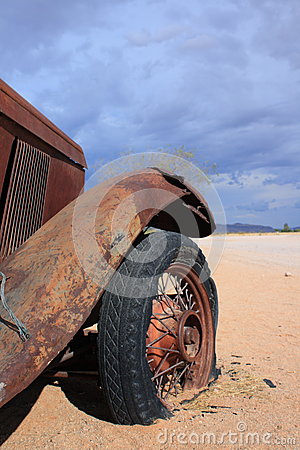 Abandoned old car with flat tire