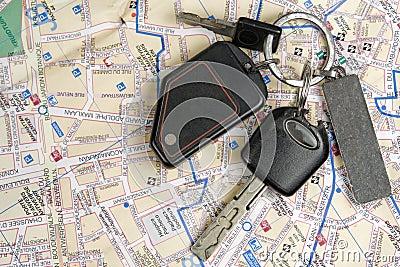 Old car keys on a map.