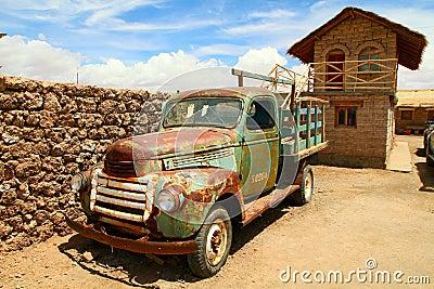 Old car near Salt flat on Salar de Uyuni