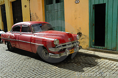Old car parked in Havana street. Cuba Editorial Image