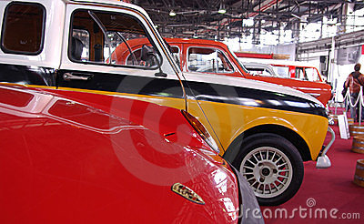 Old cars on red stage Editorial Image