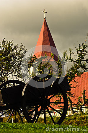 Free Old Cart In Front Of Typical Icelandic Church At Glaumbaer Farm Royalty Free Stock Photo - 63167105