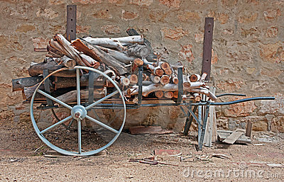 Old cart with logs