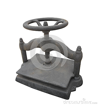 Old cast iron wheel turned book press isolated.