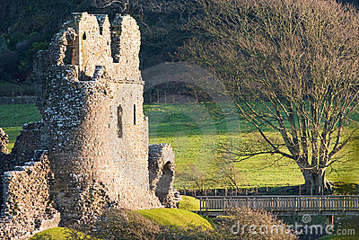 Old Castle Ruins with Bridge Lit at Sunset