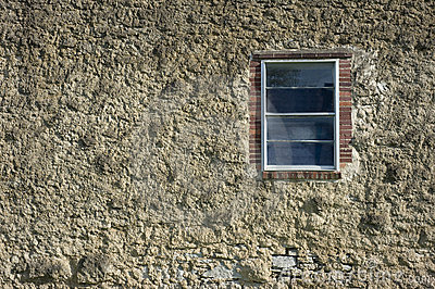 Old cement or masonry wall with window