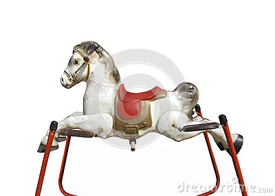 Old child's spring hobby horse isolated