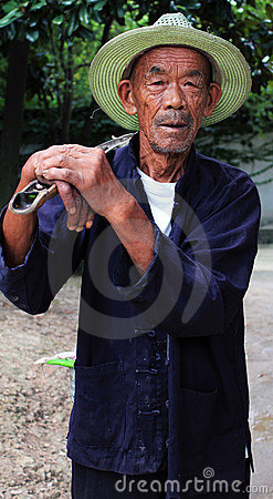 Old Chinese Farmer Editorial Stock Photo