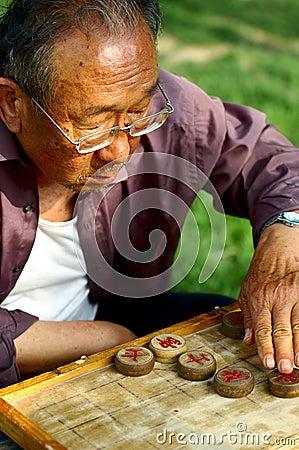 Old Chinese man play Xiangqi