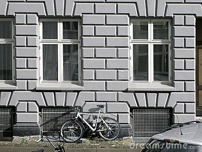 Old City House Facade with a Bike Under Windows