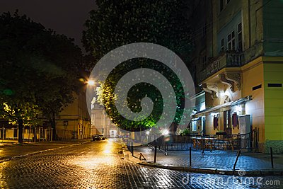 The old city of Lviv at night in the rain