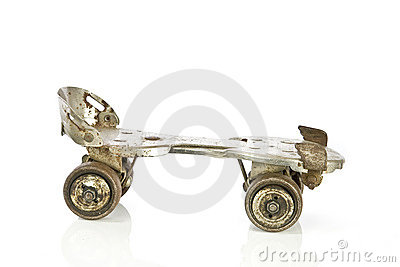 Old clamp-on roller skate on white