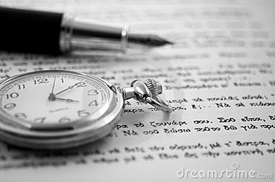 Old clock and a pen