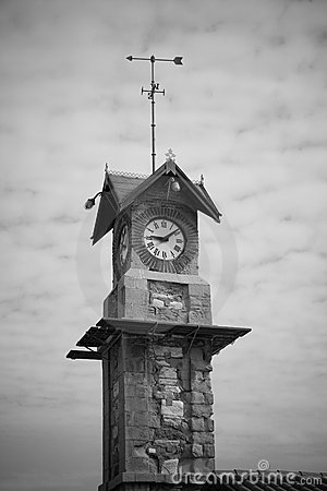 Clock tower with weather vane