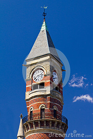 Old Clock Tower Isolated on Blue Sky