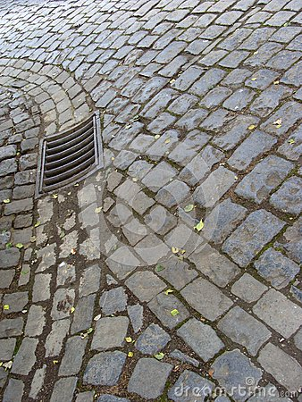 Old cobble stone street road and sewer