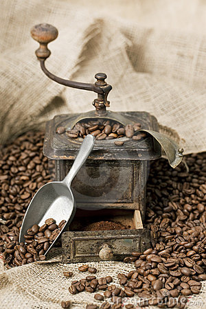 Old coffee grinder with coffee beans