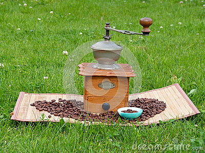 Old Coffee Grinder and coffee beans
