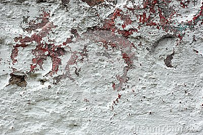 Old concrete wall with multi-layer shelled surface Stock Photo