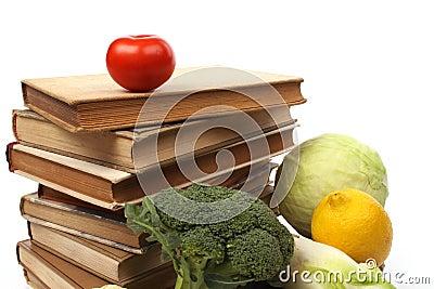 Old cookbooks with several vegetables
