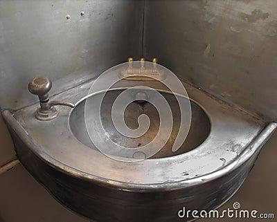 Old corner single metal sink.