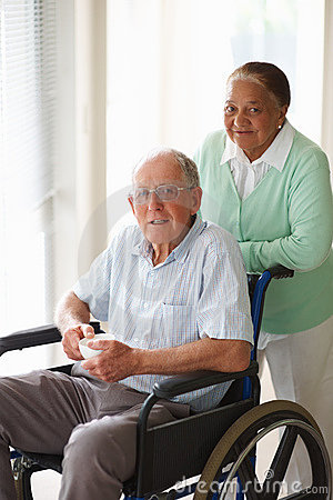 Old couple at a hospital , man on the wheelchair