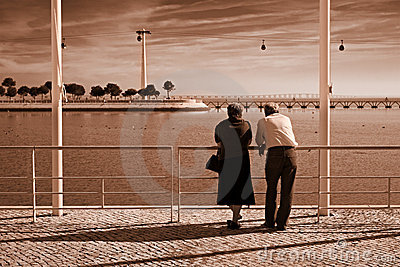 Old couple by the river