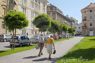 Old couple walking down the street