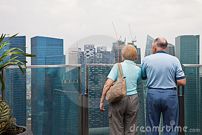 Old Couples Viewing Cityscape Editorial Photo