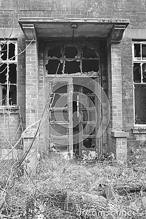 Old, creepy, abandoned building doorway.
