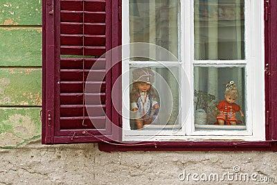 Old creepy window on cracked wall