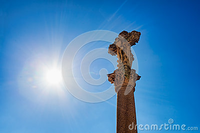 Old crucifix with sun rays