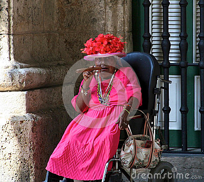 Old Cuban lady with a Cuban cigar Editorial Stock Photo