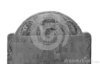 Old dark headstone isolated.