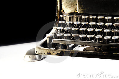 Old dark typewriter with computer mouse