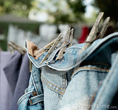 Old Denim Jeans Drying on Clothes Line Outdoors