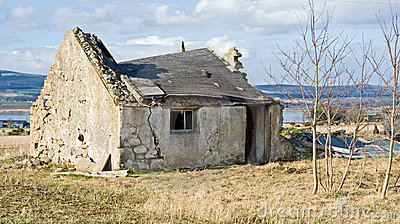 Old derelict crumbling cottage.