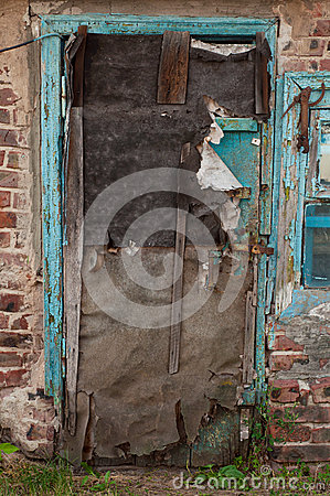 Old dilapidated ragged door
