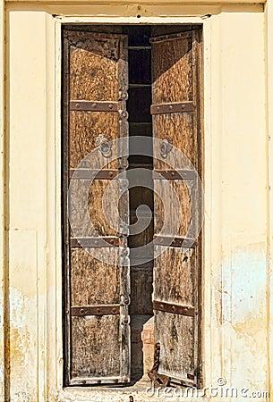 Old dilapidated wooden door.