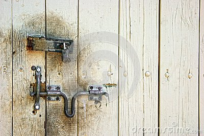 Old dirty door with lock and hasp