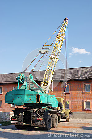 Old dirty Russian weathered truck crane